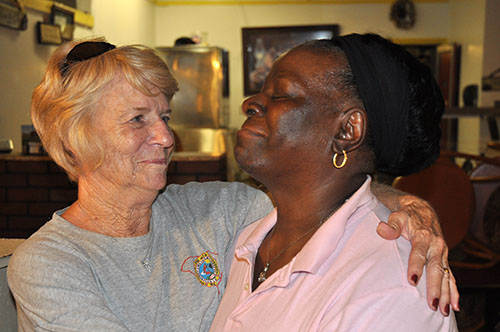SC ERT member Becky Allen and Shirley Abraham get in a big emotional hug after  ERT members helped muck-out Abraham's building and family restaurant in Holly Hill and Abraham cooked the tired and hungry team a big supper